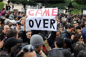 "protest sign reads ""game over"""