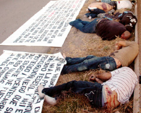 "The bodies of seven men where found dead next to a soccer field just a few meters from the Sierra Madre school in Ciudad Juarez, Chih. Tuesday, Nov. 25, 2008. The bodies had their hands tied, showed signs of torture and had a shot to the head. ""Narcomantas"" (banners with messages against rival drug gangs) where found next to the bodies.  Ciudad Juarez, Chih. Tuesday, Nov. 25, 2008. Photo: Staff / El Diario"