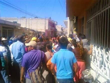 Neighbors from Chilac gather around the leader Francisco Alfaro