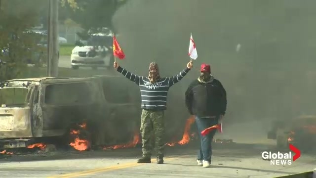 RCMP officers fired rubber bullets* and used tear gas to break up an anti-shale gas protest in eastern New Brunswick. Demonstrators retaliated by setting six vehicles, including police cars, on fire. from globalnews, new brunswick