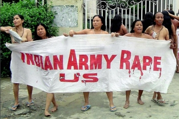 A group of Meira Paibis hold a banner as they stand naked outside the headquarters of the Assam Rifles paramilitary force in Imphal on 15 July 2004, to protest their killing of Thangjam Manorama Devi, a suspected member of the insurgent group People's Liberation Army AFP/Getty Images