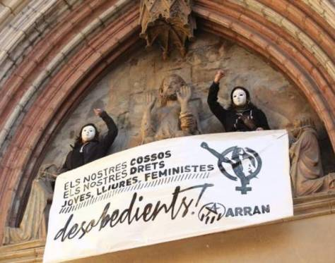 With Spain drafting unpopular anti-abortion laws, protests have been rife recently, with thousands out in the streets. However, with International Woman's Day being celebrated Saturday, a couple of daredevil protesters decided to go one step further Friday. click on photo to see article, including video, from All Voioces