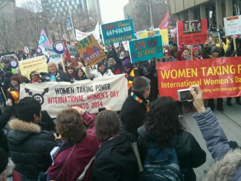 women march in the streets of toronto, canada