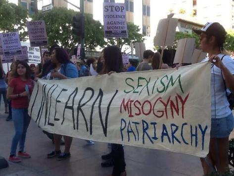 "Nice banner here at Pershing Square in LA ""Unlearn sexism, misogyny, patriarchy"" via Twitter @ChangeThruArt"
