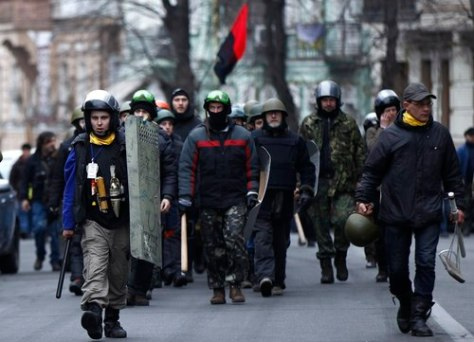 Members of self defence units march to the parliament building in Kiev February 25, 2014. REUTERS/David Mdzinarishvili