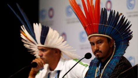 Marcos Avilques (L) and Marcio Kokoj of the Coordination of the Indigenous Organizations of the Brazilian Amazon (COIAB) address a news conference as part of the UN climate change conference COP 20 in Lima, Peru.