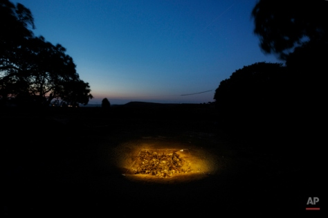 In this photo taken on July 26, 2014, skeletons are unearthed on what was a hidden mass grave during an excavation by the Aranzadi Sciences Society searching for the remains of those killed by their political ideology during and after the Spanish civil war in El Estepar, Spain. (AP Photo/Daniel Ochoa de Olza)