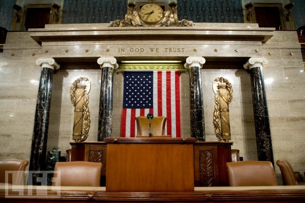 the house of congress in america's capitol - notice the fasci on either side of the flag?