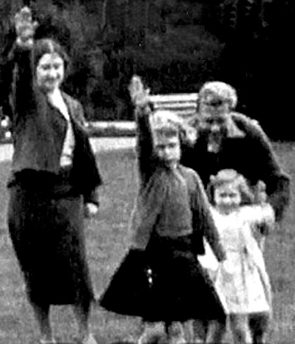 queen lizzie the 2nd as a little princess, giving the