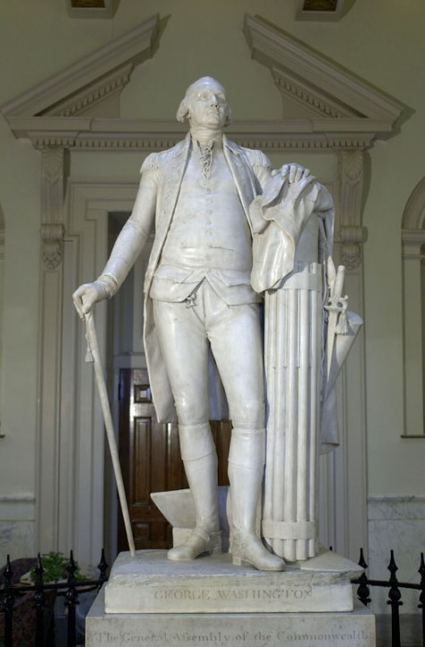 just how far back does the tradition of fascism go in the US? Here's a statue of george washington from the 18th century - resting his arm on a fasci.